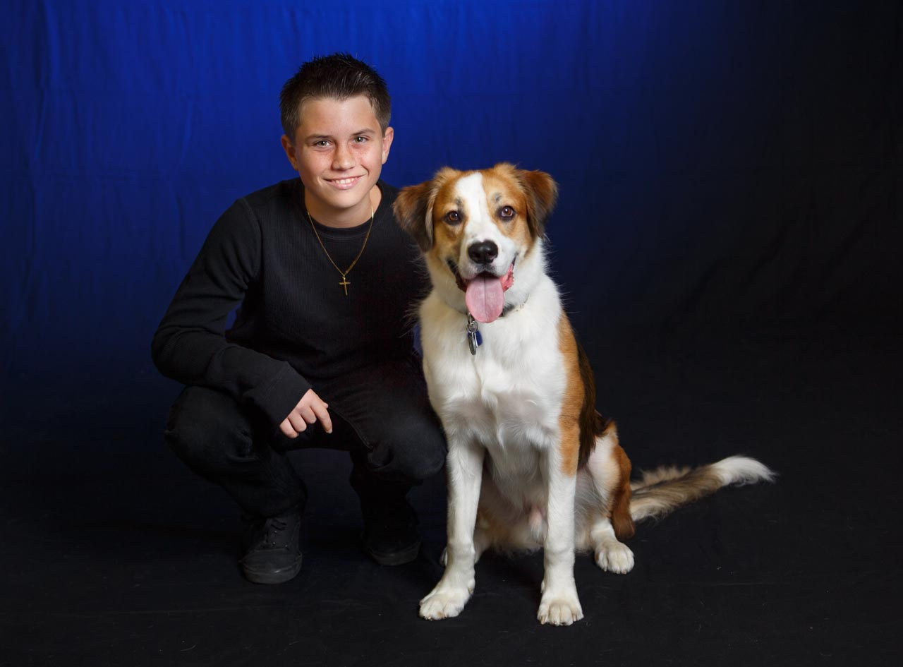 Boy and his dog in studio